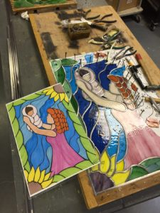woman holding baby - stained glass project